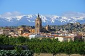 foto of snow capped mountains  - View of the town and Cathedral with the snow capped mountains of the Sierra Nevada to the rear Guadix Granada Province Andalucia Spain Western Europe - JPG