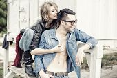 stock photo of denim wear  - stylish couple wearing jeans and boots smiling  - JPG