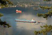 stock photo of inlet  - Oil tankers maneuver in Burrard Inlet - JPG