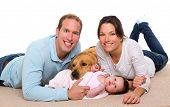 image of baby dog  - Baby mother and father happy family with golden retriever dog on carpet - JPG