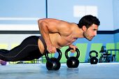 stock photo of kettlebell  - Gym man push - JPG