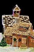 stock photo of gingerbread house  - Gingerbread house decorated with almond flakes on the roof - JPG