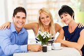 picture of mother law  - happy young man with wife and mother - JPG