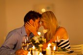 picture of romantic love  - young loving couple having romantic dinner together - JPG