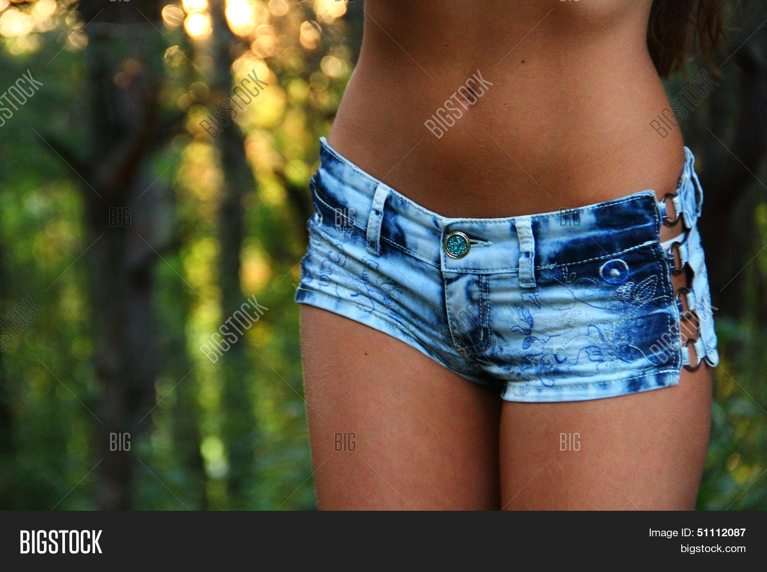 sexy belly in short denim shorts Stock Photo & Stock Images | Bigstock