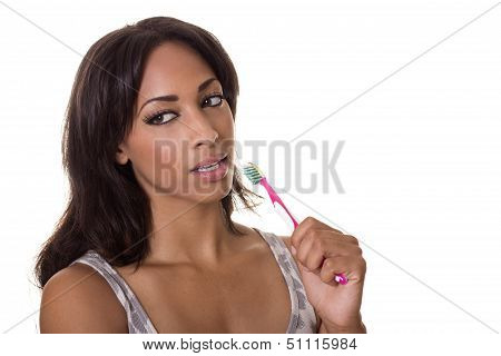 A Beautiful Woman With A Tooth Brush.