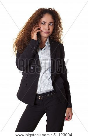 Business Woman Looks Confused While On Phone Call.