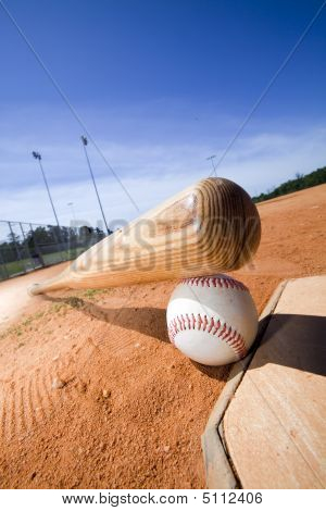 Baseball And Bat On Home Plate