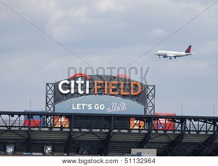 Delta Airlines jet flying over Citi Field, home of major league baseball team the New York Mets