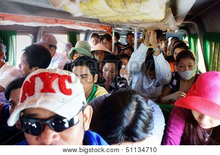 Passenger sit in overcrowded on passenger boat. Ca Mau