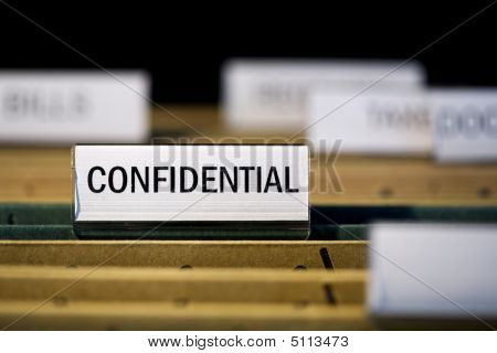 "File Folder Labeled ""confidential"" In Filing Cabinet"
