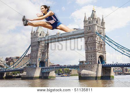 Female Athlete hurdling Tower Bridge