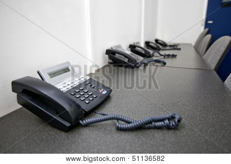 Landline telephones on table in television studio