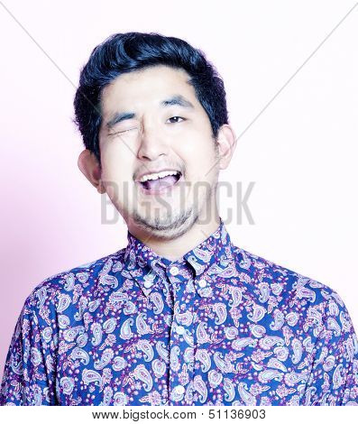 Young Geeky Asian Man in colorful shirt