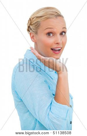 Astonished blonde woman looking at camera on white background