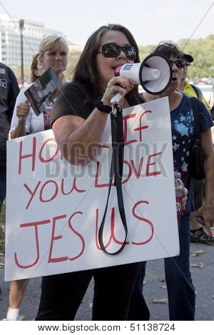 WASHINGTON-SEPT 11: A woman uses a megaphone to counter 9/11