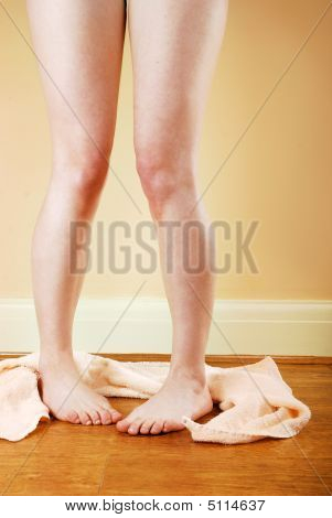 Woman's Naked Legs With Towel