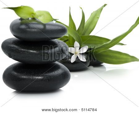 Spa Still Life With Black Stones And Bamboo Leafs On White Background