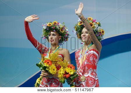 KIEV, UKRAINE - AUGUST 29: Margarita Mamun (left) and Yana Kudryavtseva of Russia win gold medals during the 32nd Rhythmic Gymnastics World Championships in Kiev, Ukraine on August 29, 2013