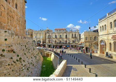 JERUSALEM - AUGUST 21: Street among houses and Tower of David - medieval fortress located near Jaffa Gate at historic entrance to Old City and is a symbol of Jerusalem, Israel on August 21, 2013.
