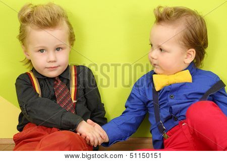 Two mods boy in bright clothes with stylish hairstyles shake hands
