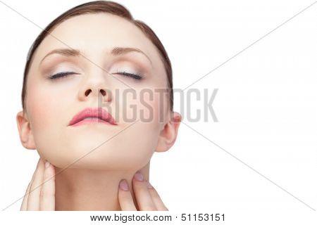 Unblemished sensual brunette posing on white background