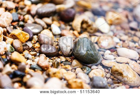A close up view of smooth polished multicolored stones on the beach. Crimea, Ukraine, Europe. Beauty world.