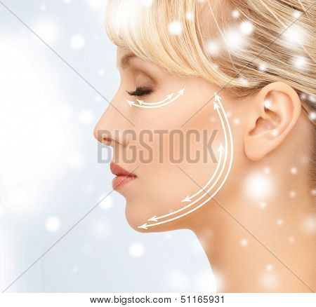 health and beauty concept - beautiful young woman face with arrows