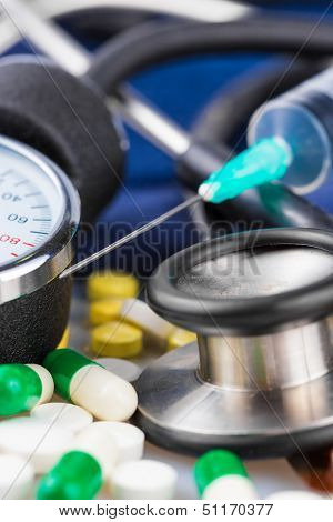 Syringe, different pills, stethoscope and sphygmomanometer useful to illustrate any medical subject