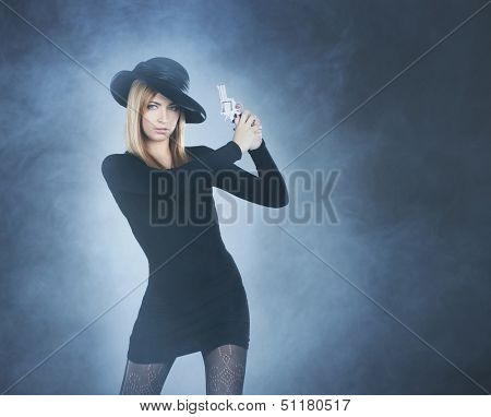Beautiful killer widow over smoky background