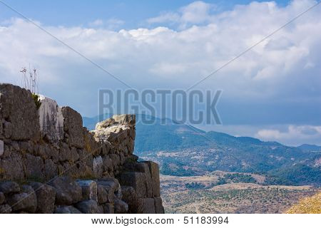 Ancient Wall Against Mountains