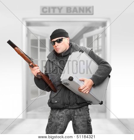 Dangerous gangster with stolen money fleeing from the bank.