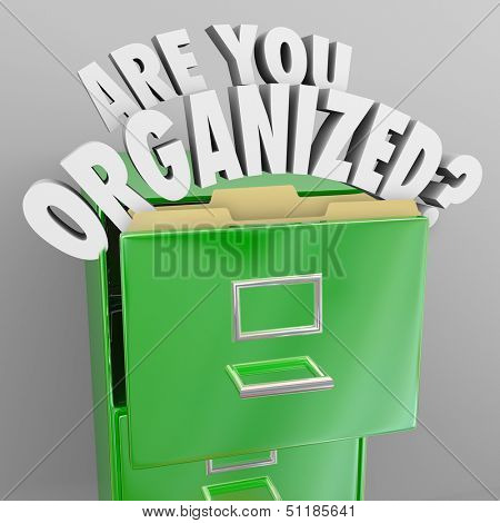 The words Are You Organized and question mark coming out of a green metal filing cabinet to illustrate organization skills and the need to file your records in a neat manner