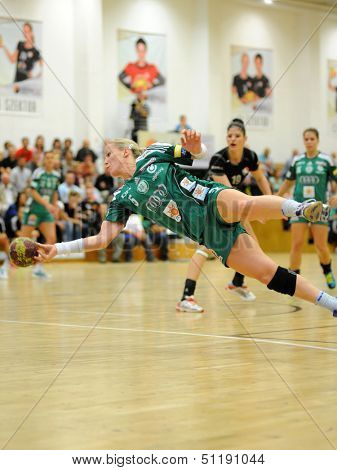 SIOFOK, HUNGARY - SEPTEMBER 14: Heidi Loke (in green) in action at a Hungarian National Championship handball match Siofok KC (black) vs. Gyor (green), September 14, 2013 in Siofok, Hungary.