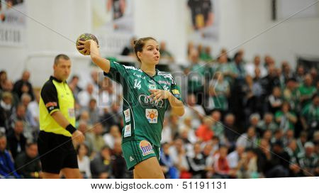 SIOFOK, HUNGARY - SEPTEMBER 14: Aniko Kovacsics (in green) in action at a Hungarian National Championship handball match Siofok KC (black) vs. Gyor (green), September 14, 2013 in Siofok, Hungary.