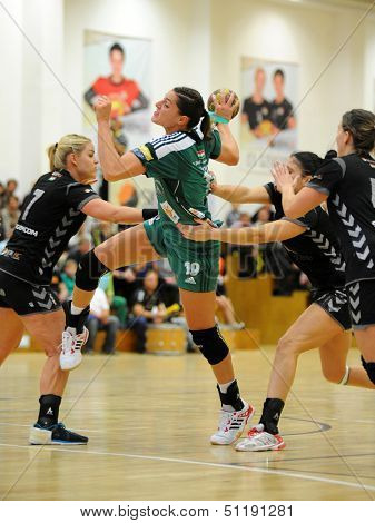 SIOFOK, HUNGARY - SEPTEMBER 14: Eduarda Amorim (in green) in action at a Hungarian National Championship handball match Siofok KC (black) vs. Gyor (green), September 14, 2013 in Siofok, Hungary.