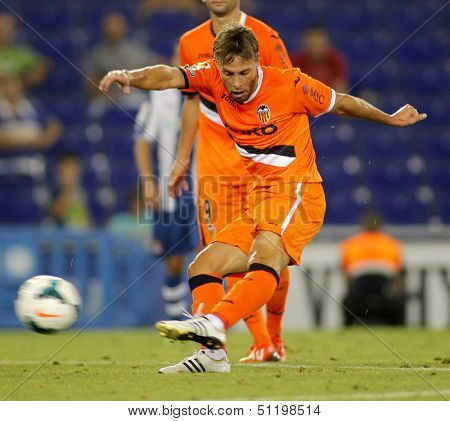 BARCELONA - AUG, 24: Sergio Canales of Valencia CF in action during a Spanish League match against RCD Espanyol at the Estadi Cornella on August 24, 2013 in Barcelona, Spain