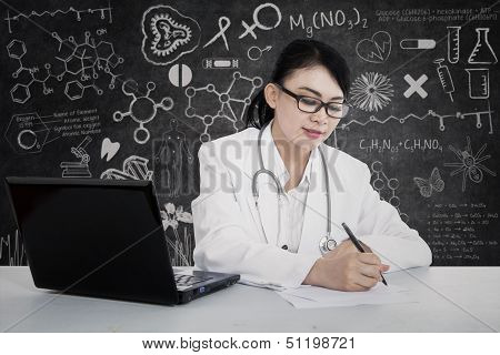 Beautiful Doctor Write Prescription At Lab