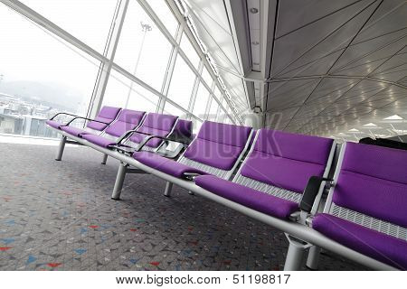 Row Of Purple Chair At Airport In Hong Kong