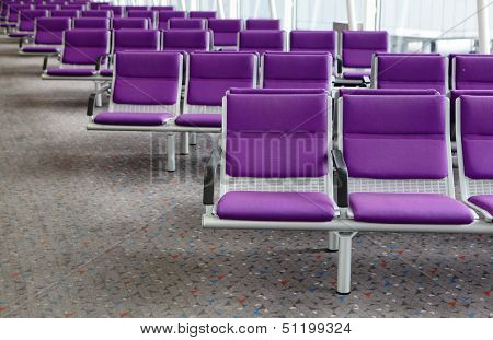 Row Of Purple Chairs At Airport