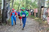 MUSKOGEE, OK - Sept. 14: Athletes dressed as Mario Brothers avoid zombies during the Castle Zombie R