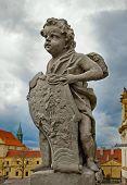 stock photo of cherub  - Sculpture of cherub outside Loreta Sanctuary in Prague Czech Republic - JPG