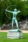 image of garden sculpture  - Sanssouci garden sculpture of archer in Potsdam vertical - JPG