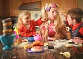 stock photo of child obesity  - A mother is acting like a child and eating lots of junk food while her children are upset with her - JPG
