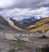 stock photo of errat  - Broad glacial valley with erratic granite boulders Cordillera Huayhuash Andes Peru South America - JPG