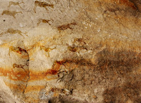 stock photo of cave-dweller  - Wall cave with drawings of the primitive person  - JPG