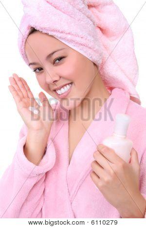 Pretty Woman Applying Lotion