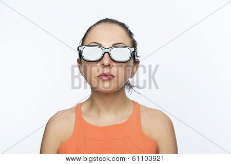 Portrait of beautiful caucasion woman wearing large 3D cinema glasses