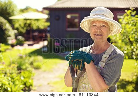 Portrait Of Female Gardener In Garden