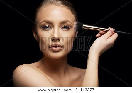 Beauty Model Applying Makeup